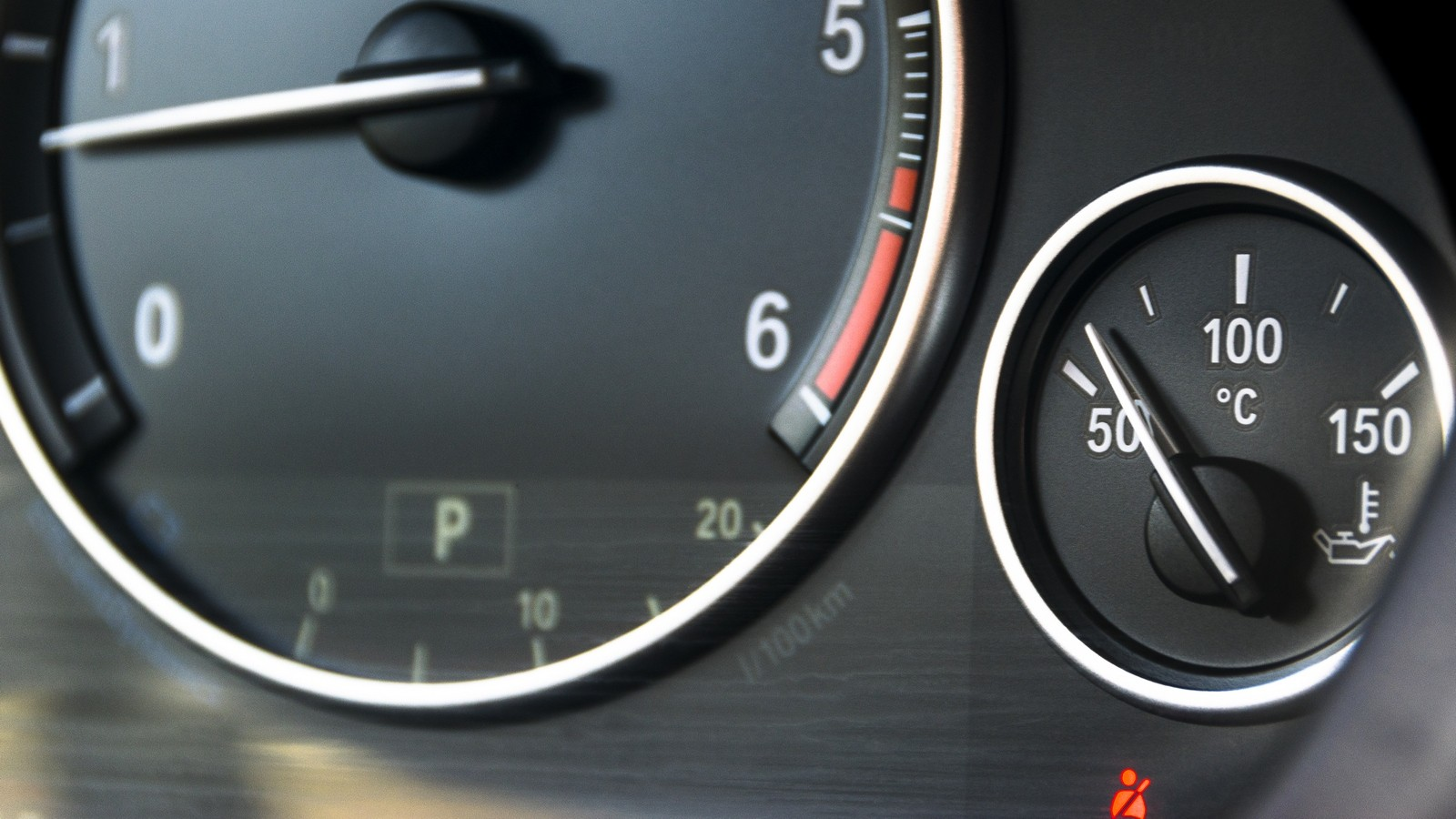 Coolant temperature gauge and tahometer on a car
